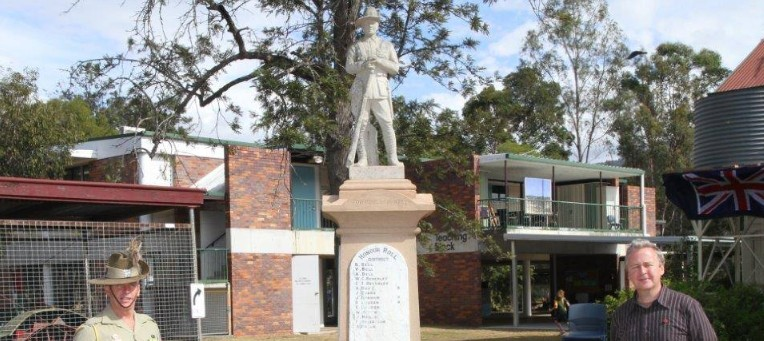 Trooper Nigel Cox (Army Museum South QLD) and Jeff Hopkins-Weise standing alongside the Mount Alford State School's War Memorial.